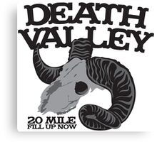 Death Valley  20 mile fill up now road sign with goat skull Canvas Print