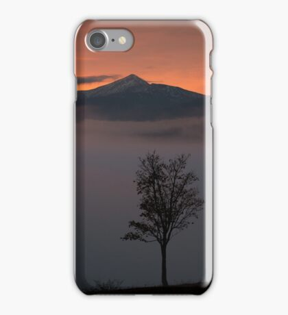 Lonely tree on background of sunrise in mountains iPhone Case/Skin