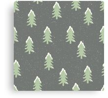 Christmas trees covered in snow on a snowy grey green background Canvas Print