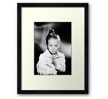 Emotional portrait of cute little girl in vintage style Framed Print