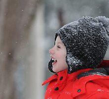 Child enjoying the snow by Gotcha  Photography