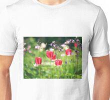 red tulips in summer garden Unisex T-Shirt
