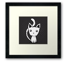 Adorable kitten on dotted background Framed Print