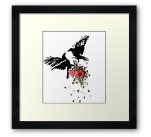 raven fighting over a bouquet Framed Print