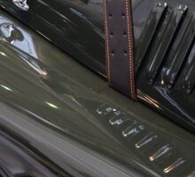Detail of classical green vintage car hood. Sticker