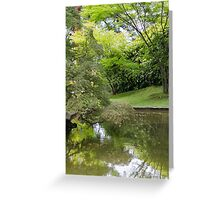 lakescape reflection with flower Greeting Card
