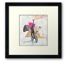 Rainbow child riding a bike Framed Print
