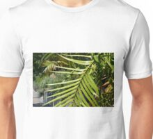 Tropical background with large green palm branch Unisex T-Shirt