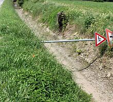 road sign shot down in the countryside by spetenfia