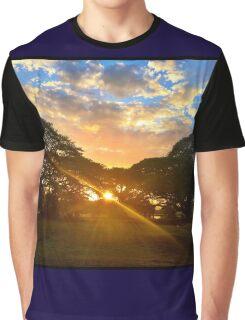 Sun setting through the rain Graphic T-Shirt