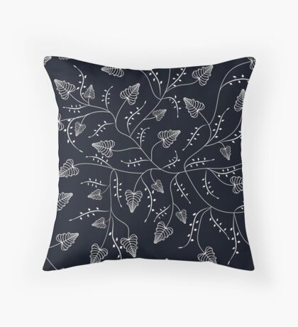 Delicate leaves on a black background . Throw Pillow