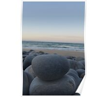rocks by the sand. Poster