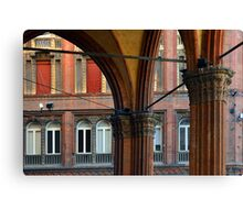 Street in Bologna with red buildings and portico Canvas Print