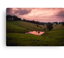 Sunsets in the water Canvas Print