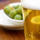 Pint of beer served with olives  by PhotoStock-Isra