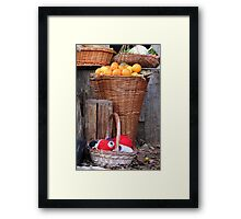oranges and balls of wool Framed Print