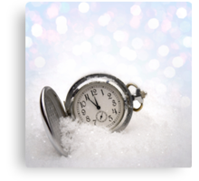 Watch lying in the snow Canvas Print