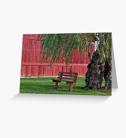 vacant bench under willow tree Greeting Card