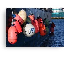 Photo of Fishing Buoys Hanging Over a Boat Railing Canvas Print