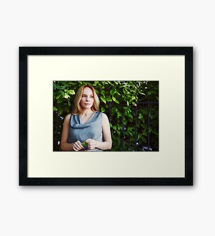 Young calm woman in the park Framed Print