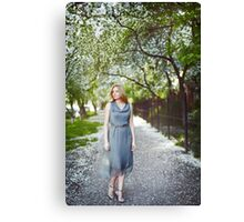 Beautiful girl in the park in spring Canvas Print