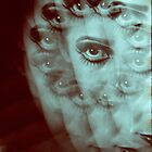 Multiple image of eye of young woman with makeup in dark analog film 35mm photo by edwardolive