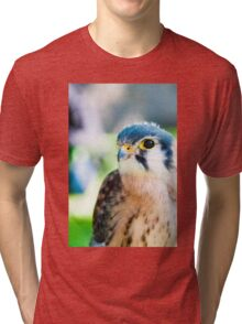 Close up portrait of small hawk against green background Tri-blend T-Shirt