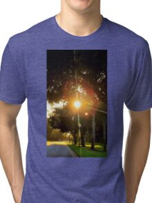 Sunset peaking through the trees! Gotcha! Tri-blend T-Shirt