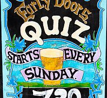 Close up on colorful British pub quiz sign by Stanciuc