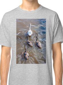 Beautiful swan familiy with nestlings in lake Classic T-Shirt