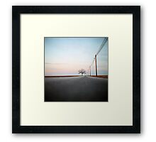 A Lonely Tree on a Long Road Framed Print