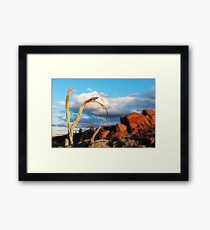 Wood, rock and sky. Framed Print