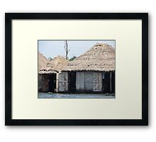 african hut on water Framed Print