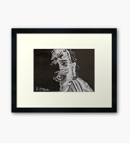 Leather face Framed Print