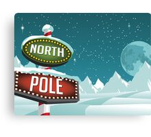 North Pole sign in a snowy Christmas scene. Canvas Print