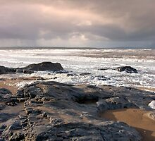 black rocks on Ballybunion beach by morrbyte