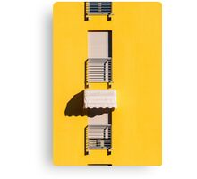 Window with sunshade on a yellow wall Canvas Print