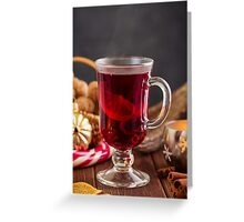Glass of mulled wine with spices Greeting Card