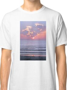 Sunset over the ocean watched by a bird on the beach Classic T-Shirt