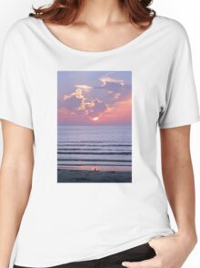 Sunset over the ocean watched by a bird on the beach Women's Relaxed Fit T-Shirt