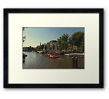 The red canal boat headed towards the light Framed Print