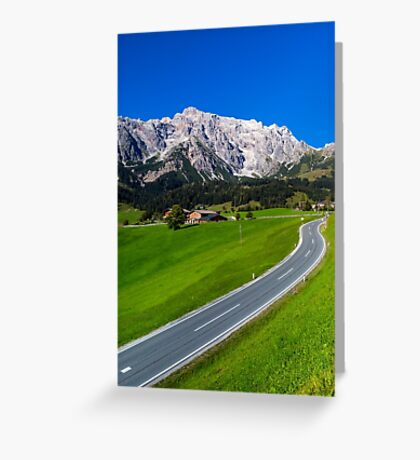 Alpine countryside road in green fields, Austria Greeting Card