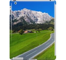 Alpine countryside road in green fields, Austria iPad Case/Skin