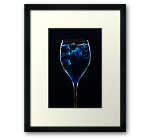Amazing blue cocktail with ice cubes close up on dark background Framed Print