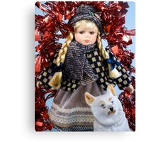 Winter gift. A muffled doll and a dog Canvas Print
