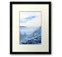 blue toned stone wall shelter on a beautiful beach Framed Print