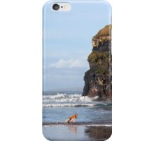 blur motion of dog running in sea by cliffs iPhone Case/Skin