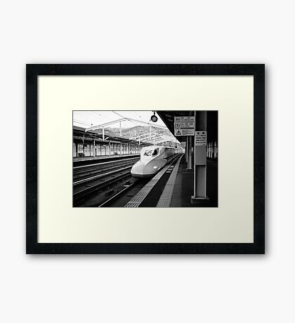 Shinkansen Pulling into the Station Framed Print