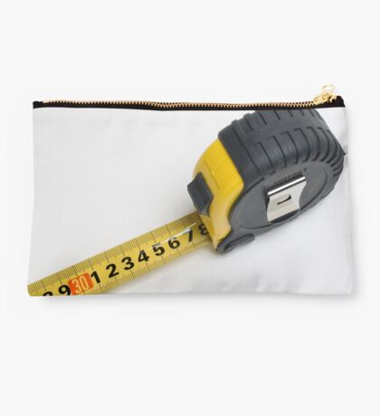 a yellow measuring tape on white background Studio Pouch