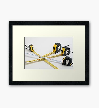 4 yellow and one unique white measuring tape on white background Framed Print